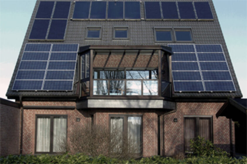 Residential building with solar thermal and photovoltaic panels